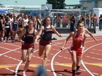 Action in Perlims of 4x100m relays at CCS as Erika B. passes to Addy E. in the final exchange.
